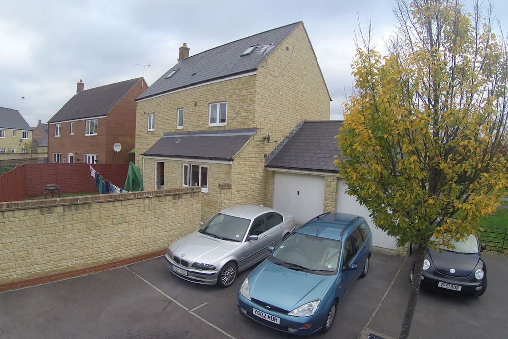 Rear of the house with private Driveway parking and Garden area.