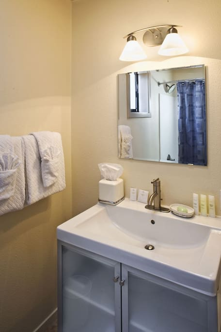 Modern, updated bathrooms with EO Organic Amenities