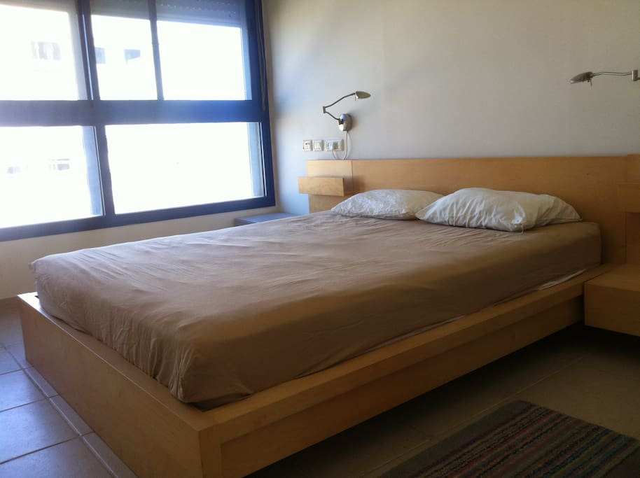 spacious bedroom with a private bathroom, shower and Walk-in closet.