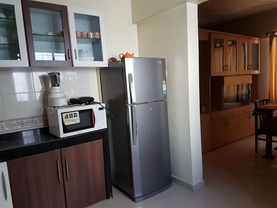 Kitchen with fridge,Microwave,Kitchen trollies and all cooking setup. Can either cook or even can order from outside.