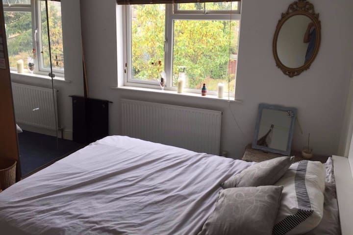Spacious double bedroom. 15 mins walk to station.