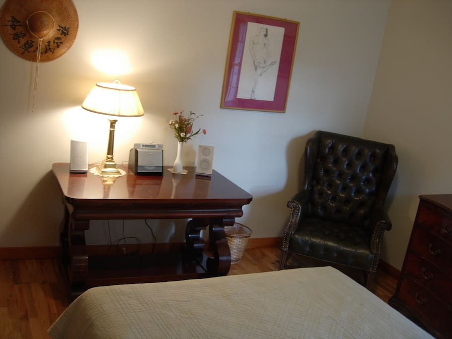 The room has an antique table you may use as a desk with a stereo radio/CD/MP3 player.  Wireless internet is available or relax in the corner chair with a good book.