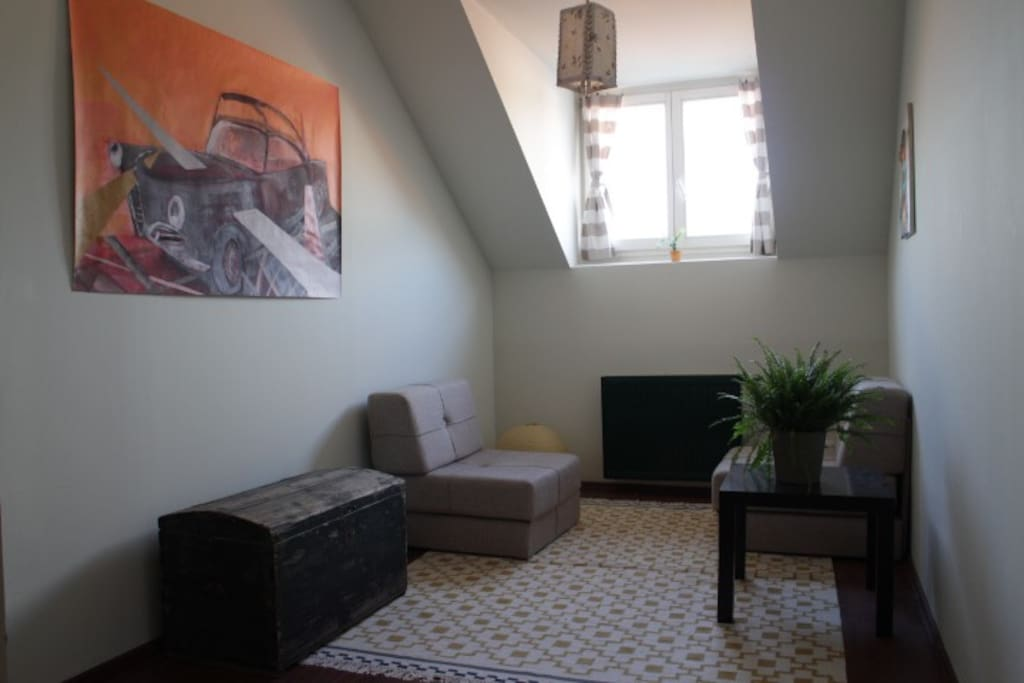 The sitting area and window in your room