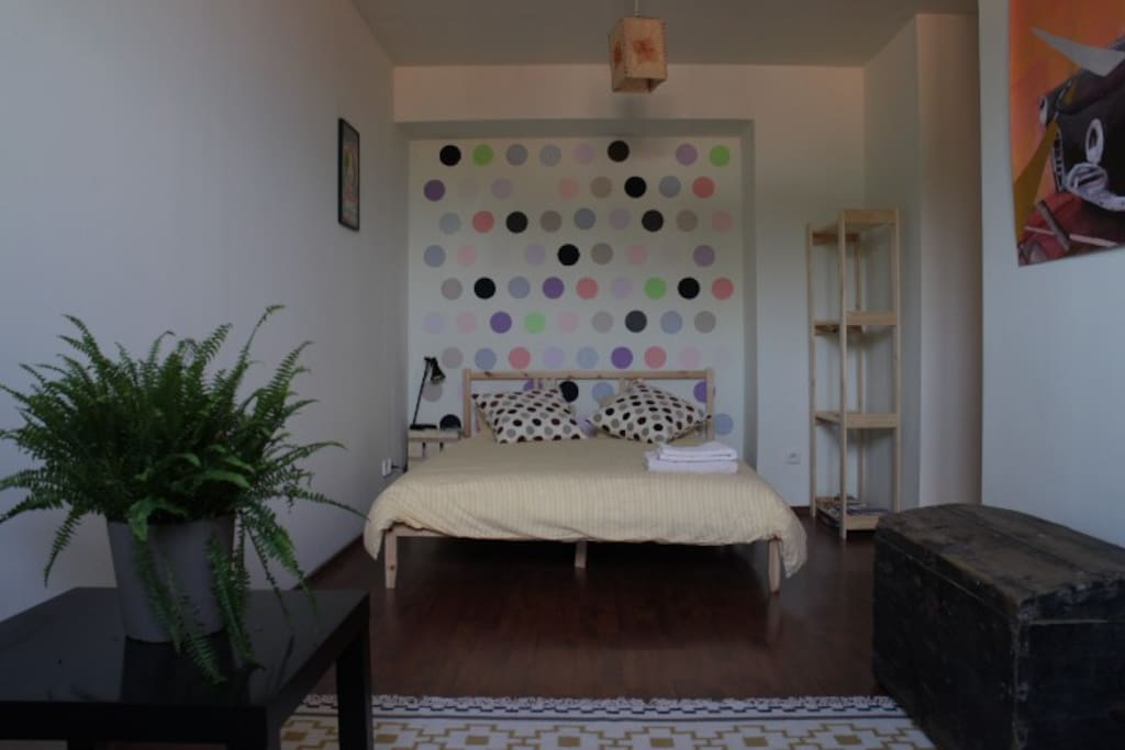 Comfy double bed with spotty feature wall