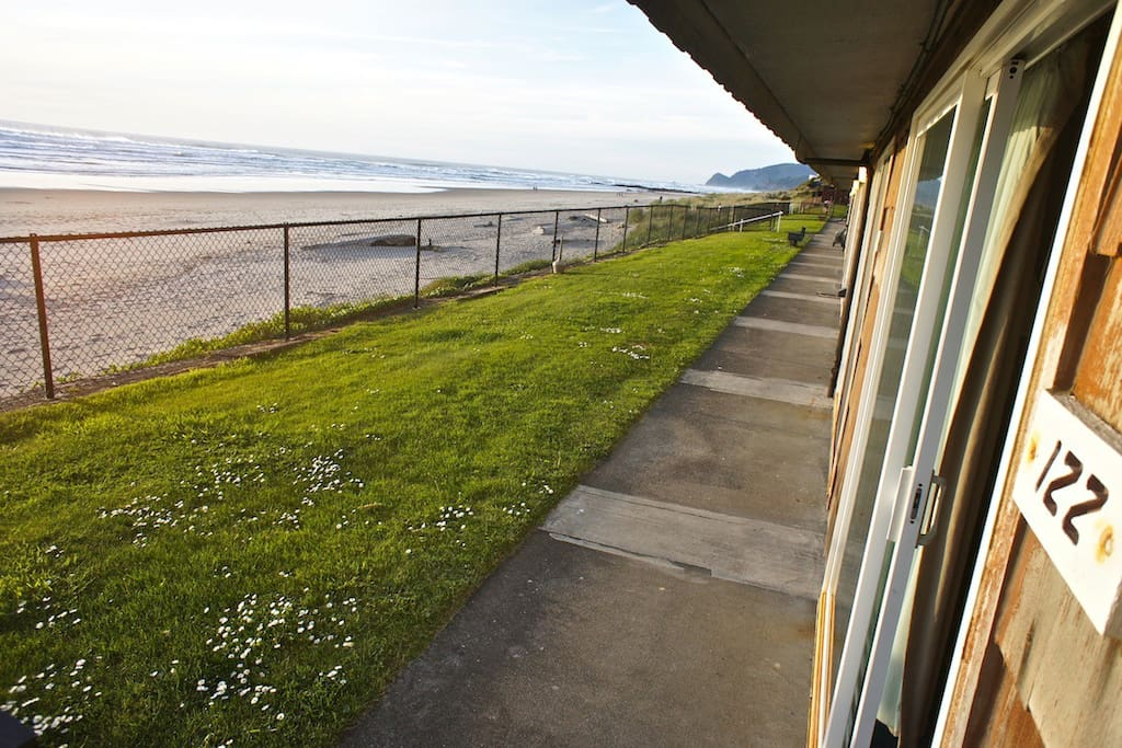 Peak out your slider door and see beach for miles!