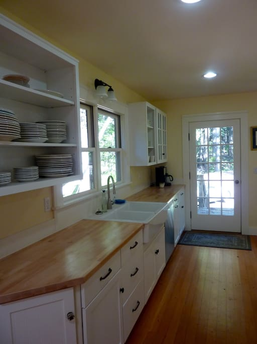 The kitchen has all new appliances and is fully stocked with all of the necessary cookware and dishes.