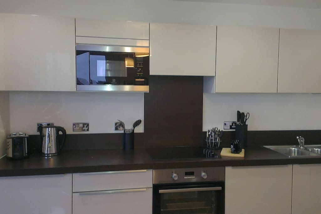 Fitted kitchen with microwave, oven and dishwasher
