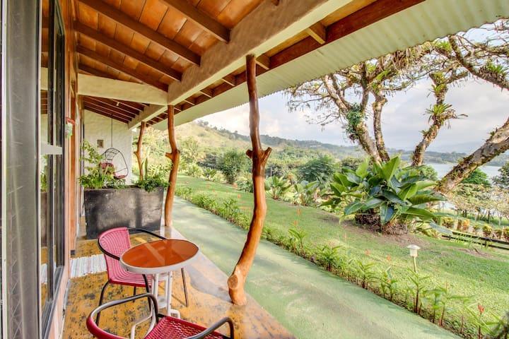 Dog-friendly Arenal cabana w/ lake views and shared pools!