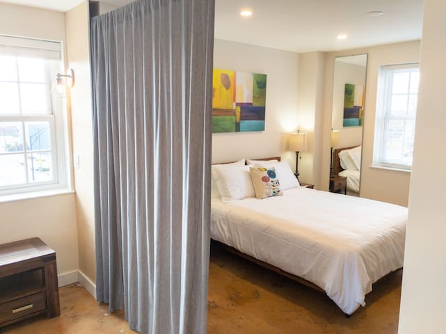 The main bedroom features a comfortable queen bed and opens directly into the living space.