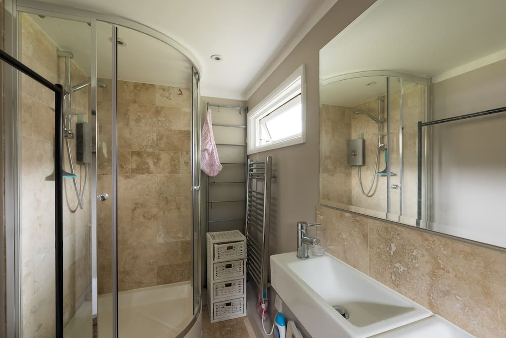 En suite bathroom with shower and double basin