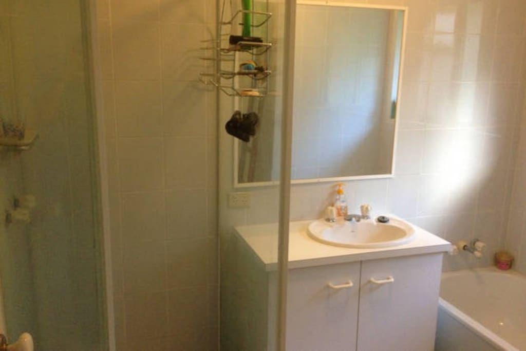 Shared bathroom - shower, bath & sink.