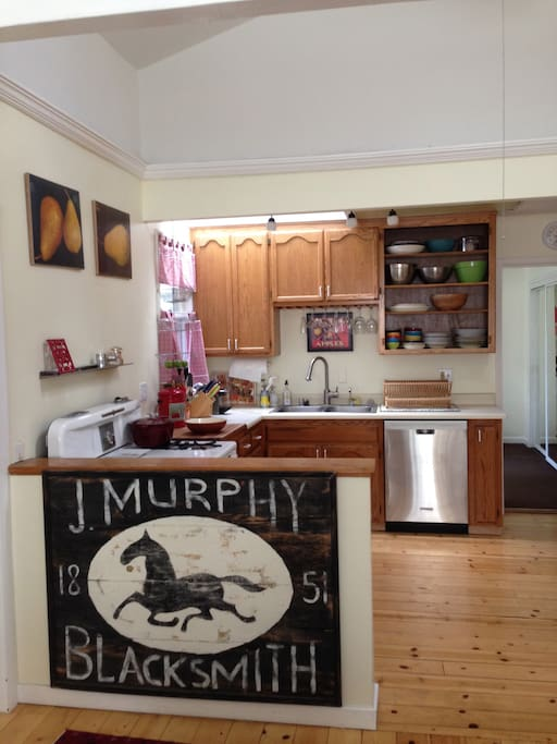 Open living plan with Wedgwood stove