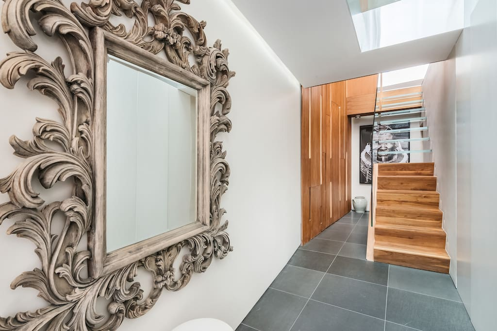 Spacious entrance hall with view of the beautiful staircase to the Upper Level