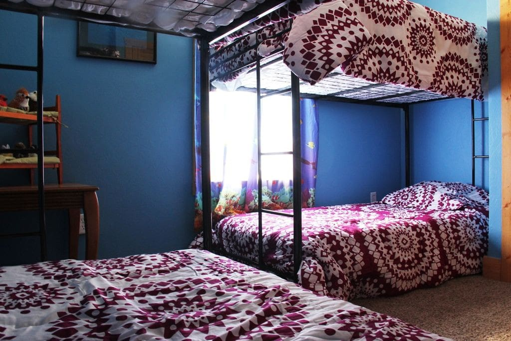 2 bunk beds in a cheery room