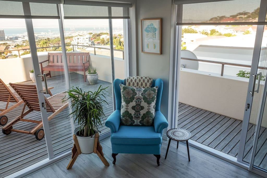 A place to sit in the master bedroom. Opening up onto a wrap around balcony with sun chairs.