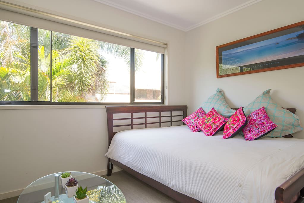 Privet lounge room with day bed, Tv, Foxtel, DVD/ book library