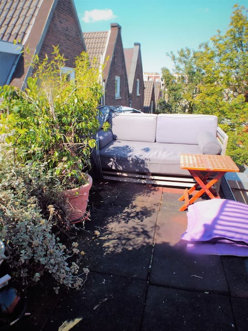 All day sun on simple roof top. Great lounging. Access from the bedroom.
