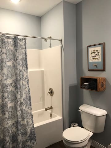 Bathroom for double bedroom is private from the large living space.