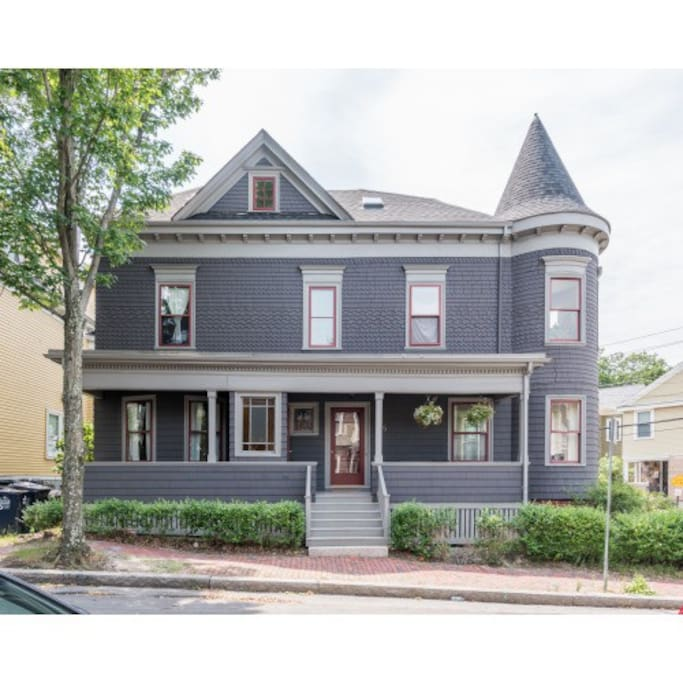 Classic 1896 Victorian with inviting porch, perfect for your morning coffee or evening cocktails!