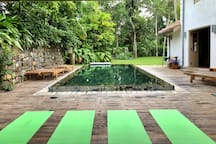 All set up for morning yoga by the pool. Private or private group lessons can be arranged at the house.