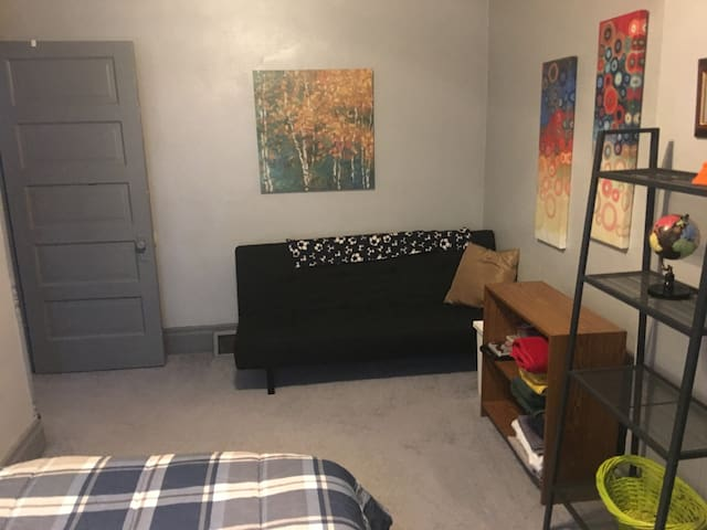 Bedroom includes sitting space with small futon and flat screen TV (not pictured).