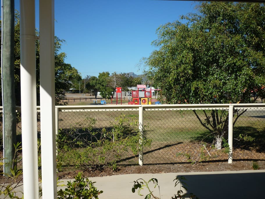 View from front patio of park with children's playground.