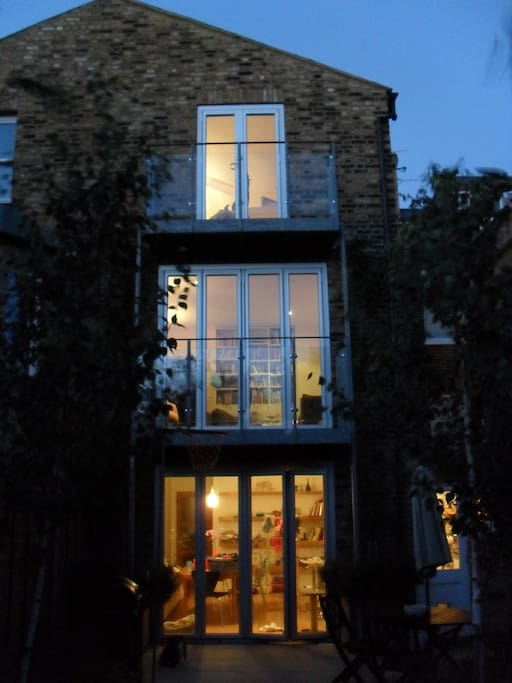 Rear of house - sliding glass doors leading to balconies over looking 100ft garden