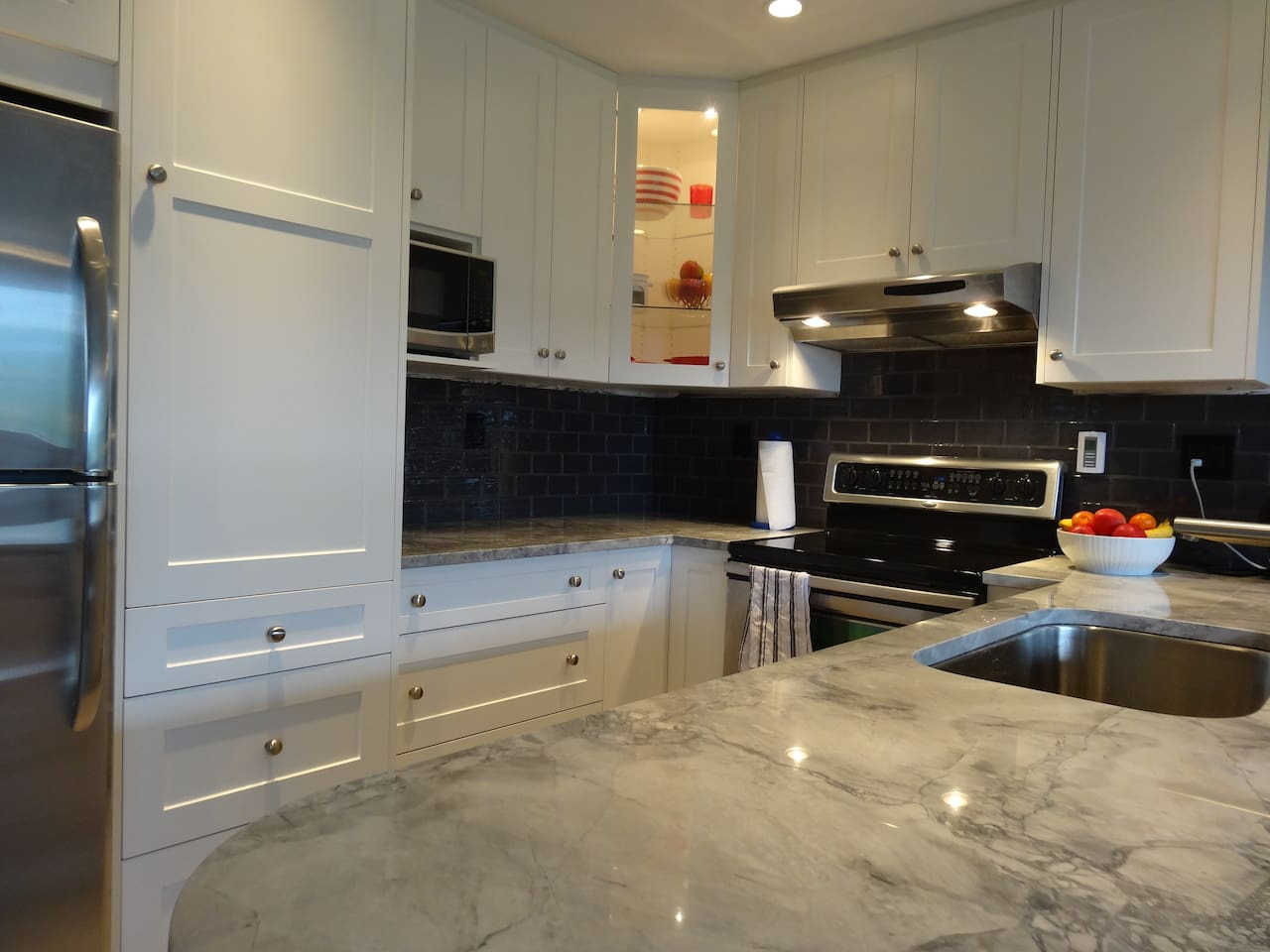new kitchen with large granite counter