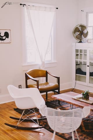 House is bright and airy, with a mix of mid-century and primitive furniture.