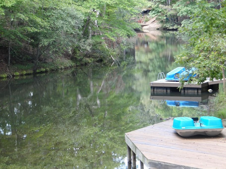 Dock directly behind house. Paddle boat and kayak.