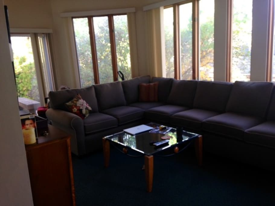 Plenty of room for everyone in the family room with large TV, cable & wifi.