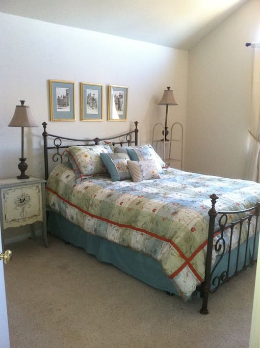 The light and airy bedroom with queen bed.  Enjoy the mountain views.