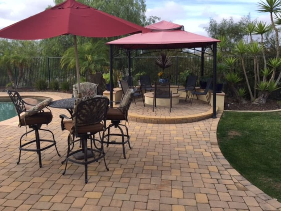 Bar seating with a gas fire pit in the background