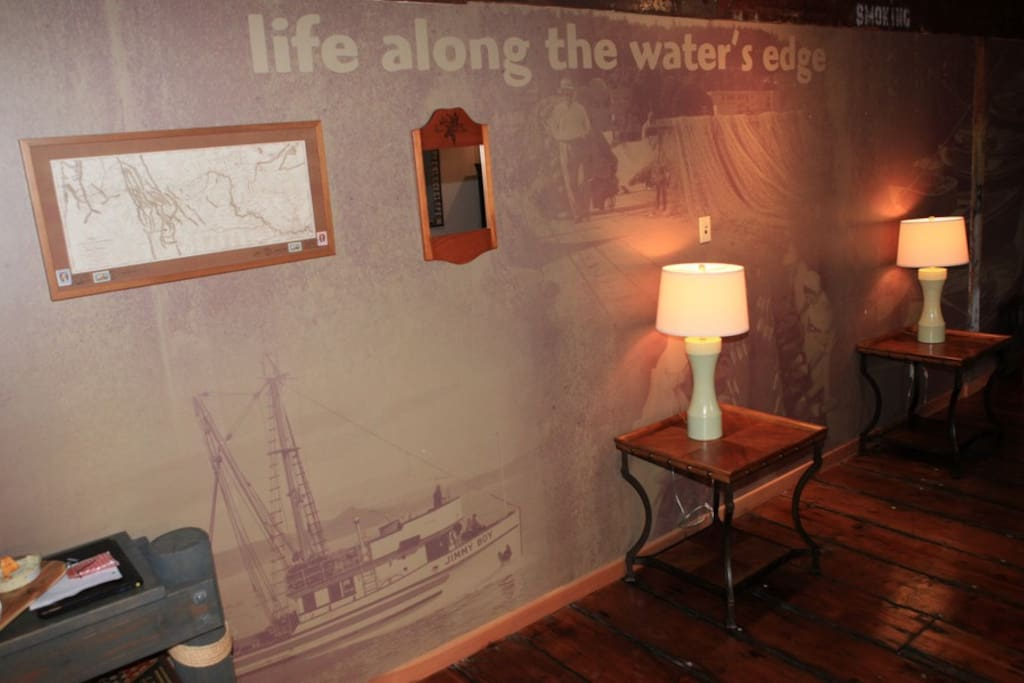 Custom murals decorate the walls, depicting life as it was 100 years ago when the Salmon ruled the river.