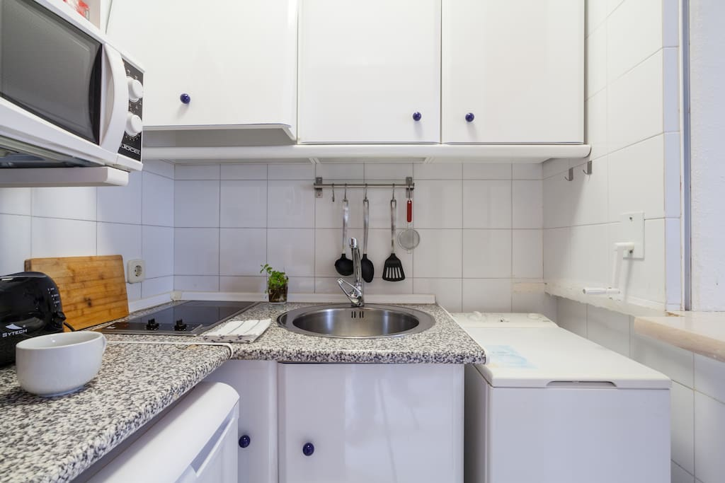 Fully equipped kitchen, where you have breakfast and some meals and drinks.