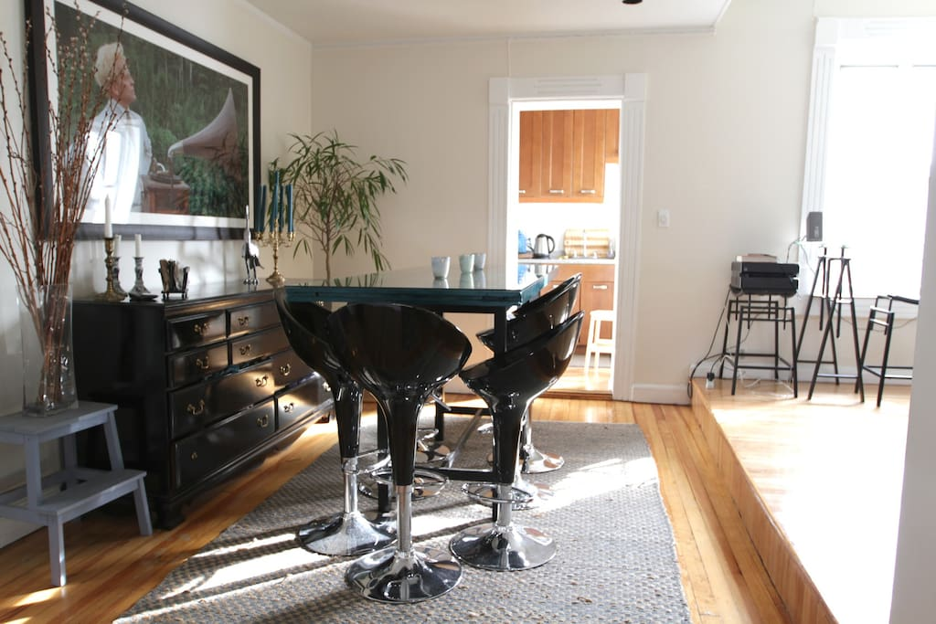 Sun-drenched dining room with a table for eight.