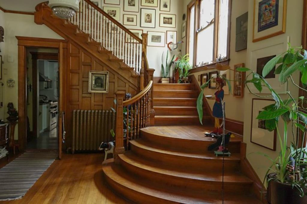 Quarter-sawn oak throughout.  This staircase convinced us to buy the house.  The pocket doors and cherubs on the radiators didn't hurt.