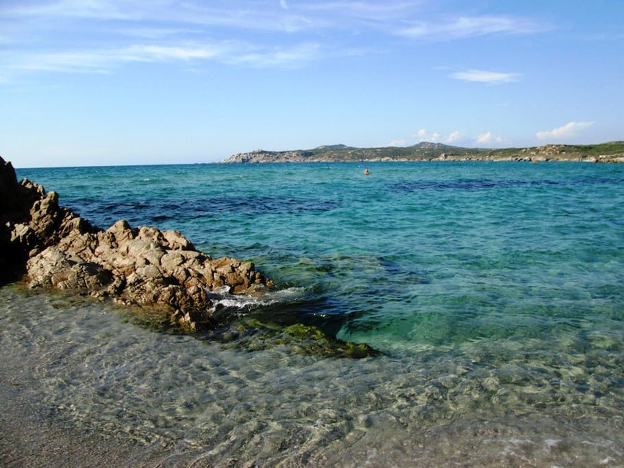 Rena Majore beach during the day with its beautiful turquoise waters.