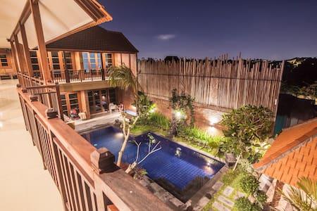 Wiras Village canggu deluxe double bed room1
