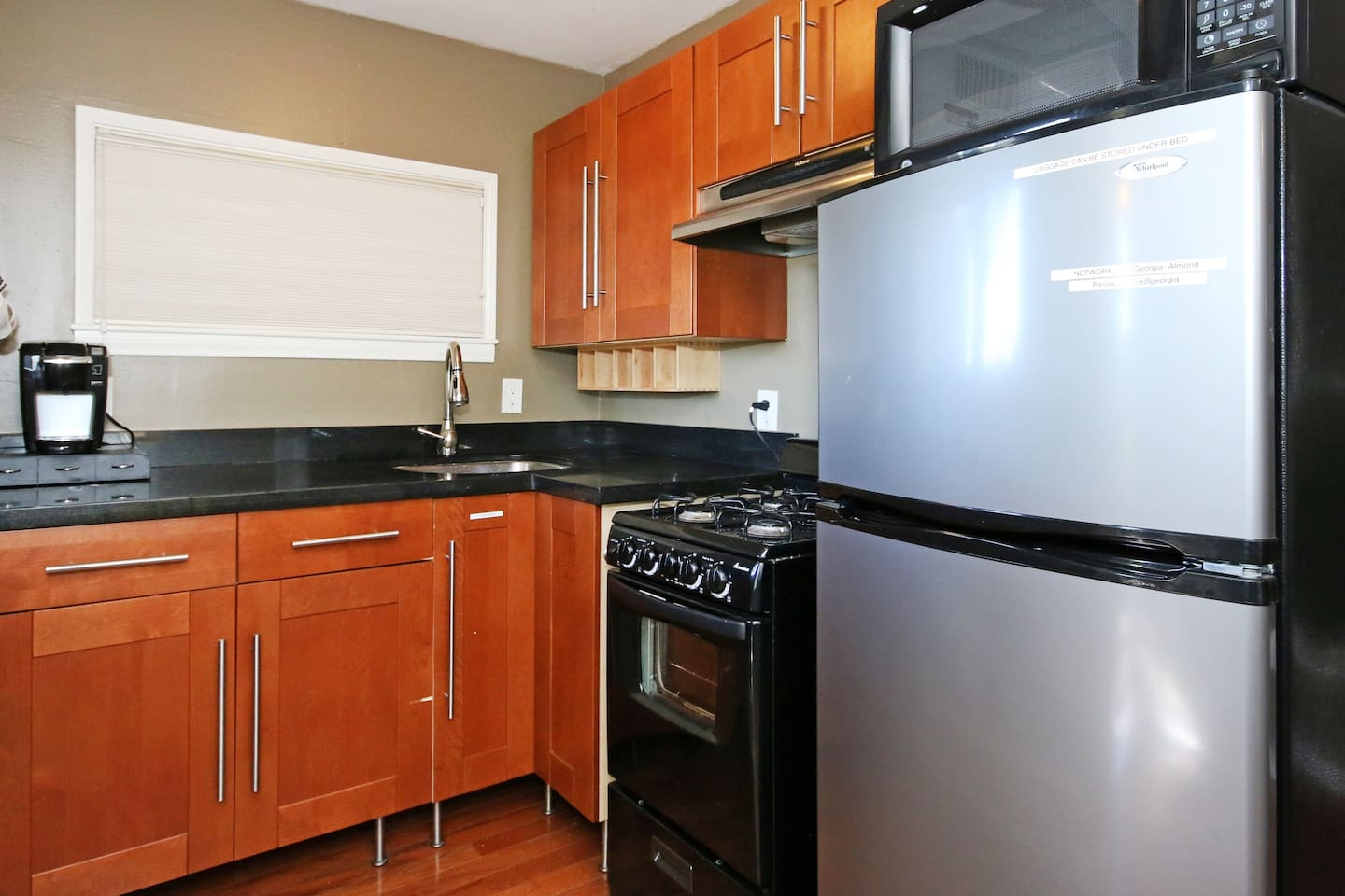 Updated kitchen. Stainless steel Refrigerator.  Gas stove with Oven. Granite countertop.