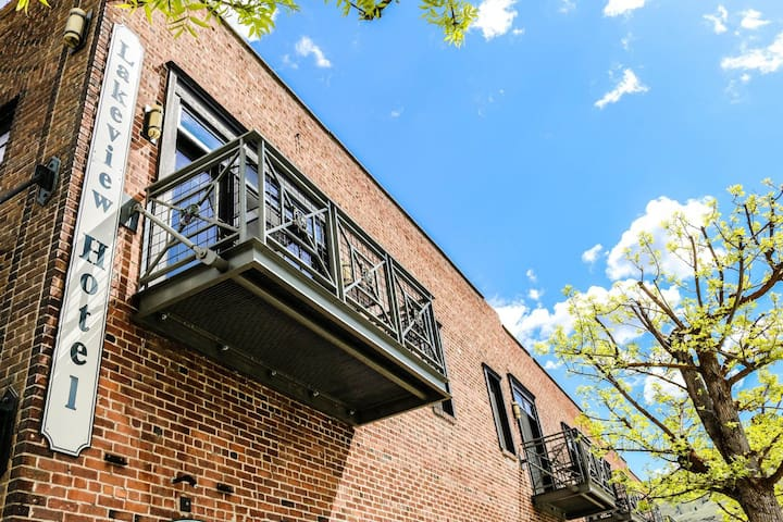 Luxury suite w/ fireplace, spa tub, & onsite restaurant.