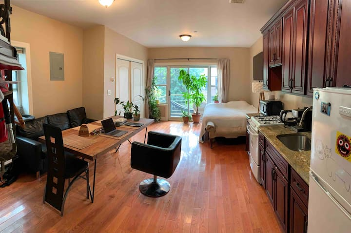 Studio with private half-bathroom and shared full