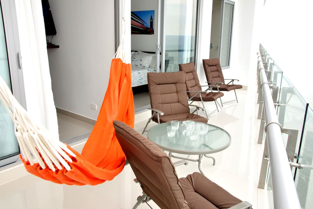 Balcony with hammock and comfy chairs