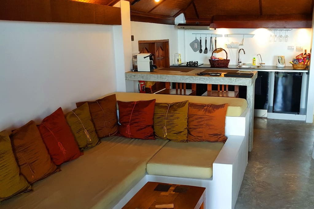 Open-planned living area, breakfast bar and kitchenette
