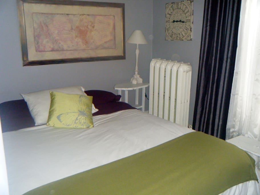 Soothing colours in the Butterfly Room with a queen bed as well.