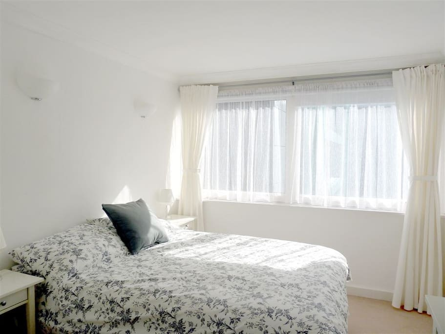 Double bed, double fitted mirrored wardrobe, chest of drawers, bedside table, large double glazed windows, black out blinds
