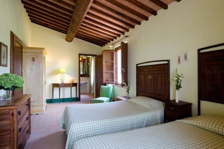Bedroom 2 - This first floor bedroom in the main villa has two French beds, a small balcony and an en suite bathroom.