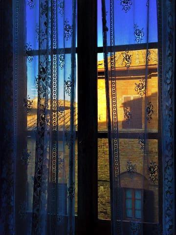 particulary : the windows, full historical center san gimignano Tuscany