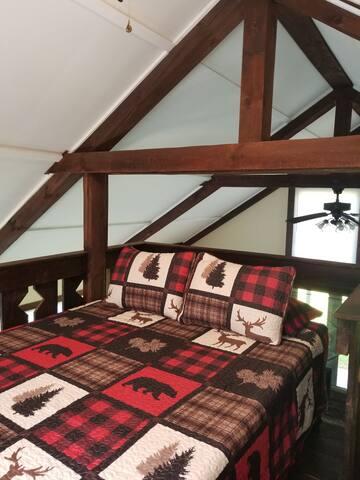 Queen size bed in loft with memory foam mattress.