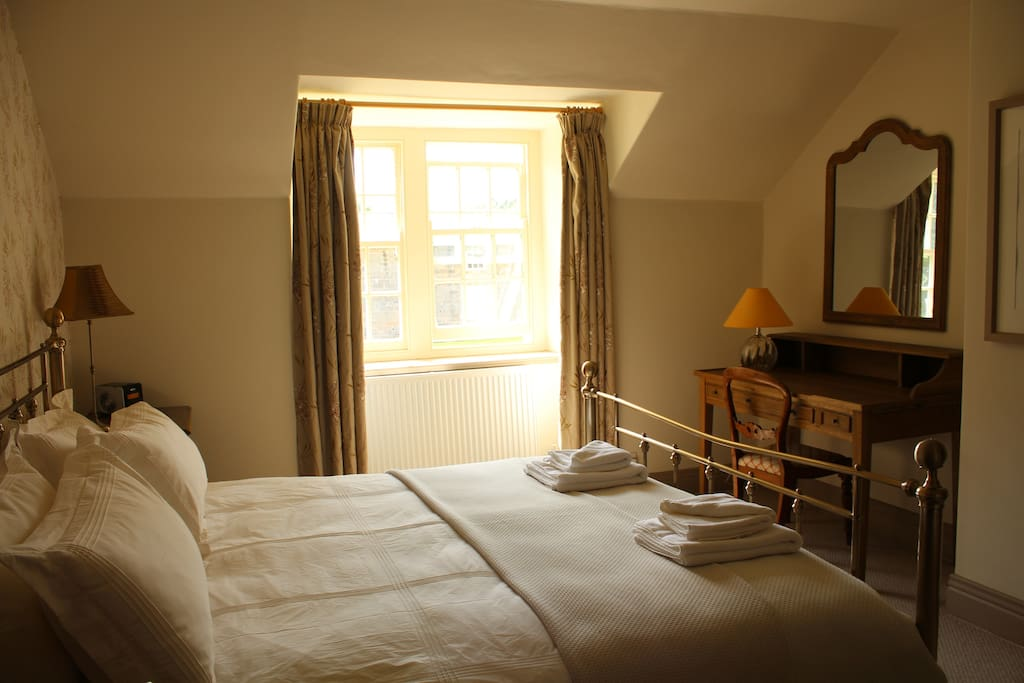Main double bedroom with a view into the courtyard of Ingleby Manor.